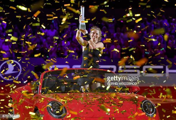 Germany's Laura Siegemund poses with trophy after winning the final match against France's Kristina Mladenovic at the WTA Tennis Grand Prix in...
