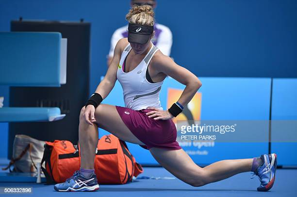 TOPSHOT Germany's Laura Siegemund stretches during her women's singles match against compatriot Annika Beck on day six of the 2016 Australian Open...