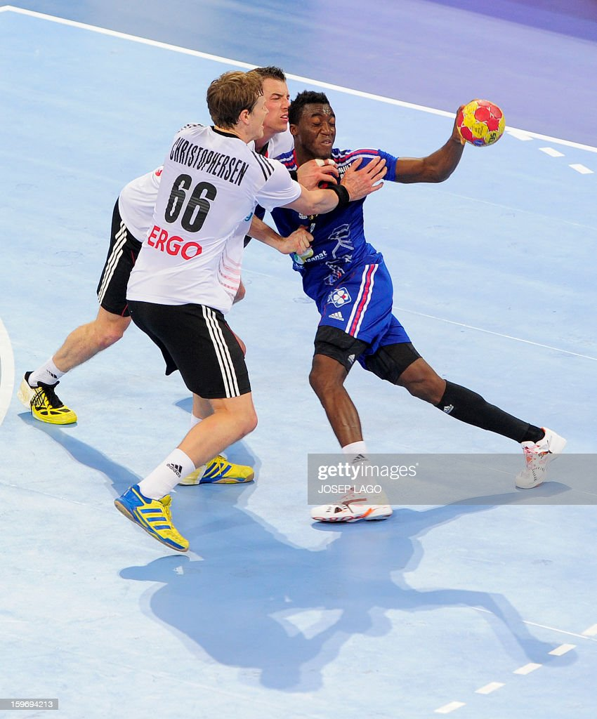 Germany's left back Sven-Soeren Christophersen (L) and Germany's left wing Dominik Klein (C) vies with France's right wing Luc Abalo (R) during the 23rd Men's Handball World Championships preliminary round Group A match France vs Germany at the Palau Sant Jordi in Barcelona on January 18, 2013.