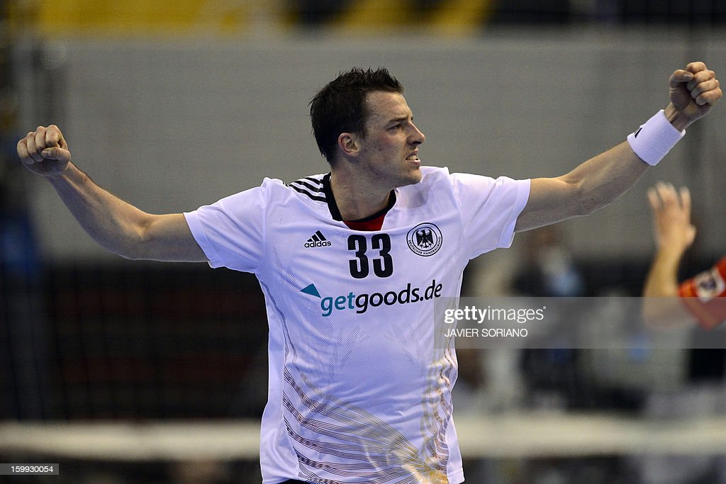Germany's left wing Dominik Klein celebrates after scoring during the 23rd Men's Handball World Championships quarterfinal match Spain vs Germany at...