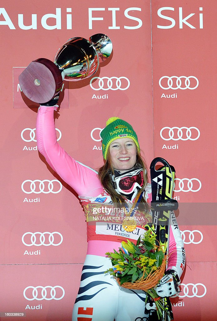 Germany's Lena Duerr celebrates on the podium after the FIS Ski World Cup Parallel Slalom city event in Moscow, on January 29, 2013. Lena Duerr won the competition.