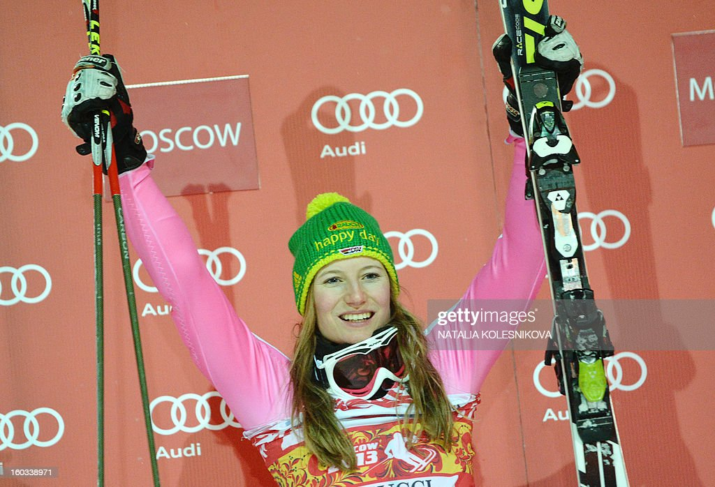 Germany's Lena Duerr celebrates on the podium after the FIS Ski World Cup Parallel Slalom city event in Moscow on January 29, 2013. Lena Duerr won the competition.