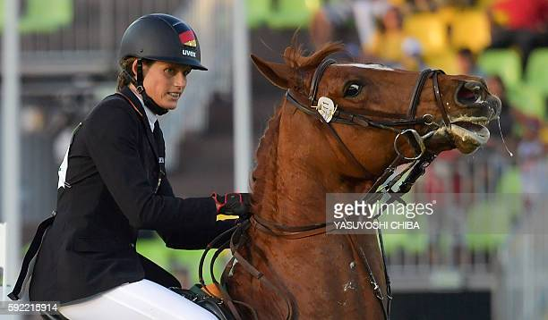 Germany's Lena Schoeneborn competes in the show jumping portion of the women's modern pentathlon event at the Deodoro Stadium during the Rio 2016...