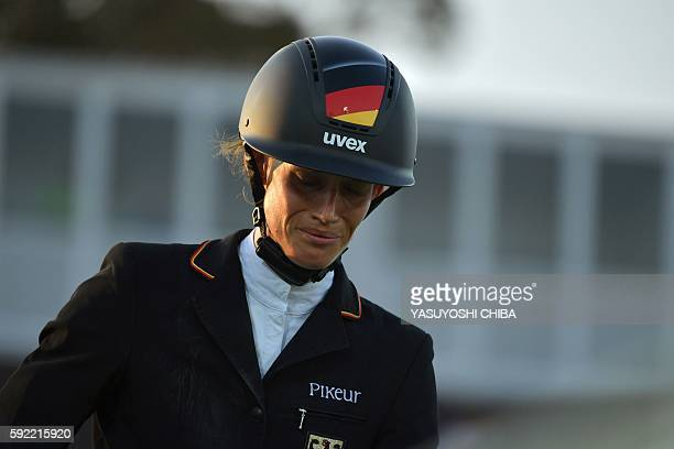 Germany's Lena Schoeneborn reacts after being unable to finish the horse show jumping portion of the women's modern pentathlon event at the Deodoro...