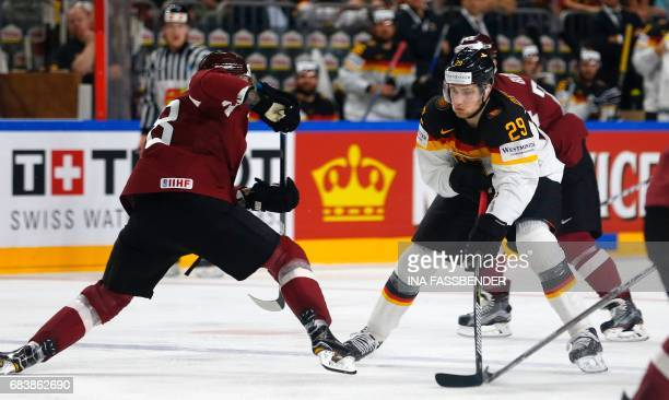 Germany's Leon Draisaitl and Latvia's Guntis Galvins during the IIHF Men's World Championship Ice Hockey match between Germany and Latvia in Cologne...