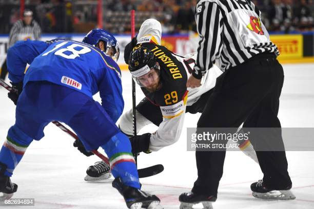 Germany´s Leon Draisaitl vies for the puck with Italy's Anton Bernard during the IIHF Ice Hockey World Championships first round match between Italy...