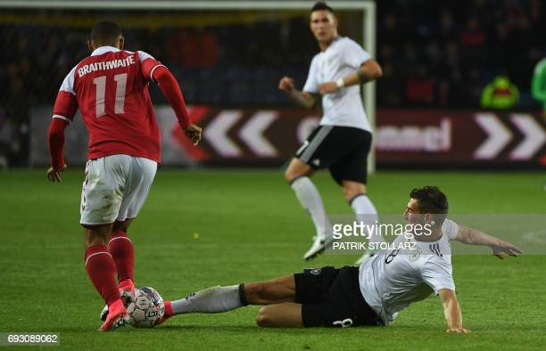 Germany´s Leon Goretzka and Denmark´s Martin Braithwaite vie for the ball during the friendly football match between Denmark and Germany in Brondby...