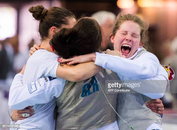 Germany's Leonie Ebert Anne Sauer and Eva Hampel celebrate after winning the qualification against the team of France during the Women's Team Foil...
