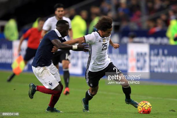 Germany's Leroy Sane and France's Bacary Sagna battle for the ball