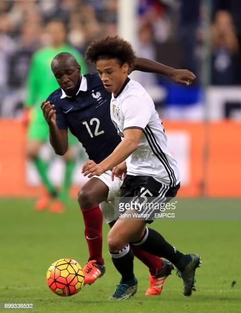 Germany's Leroy Sane and France's Lassana Diarra battle for the ball