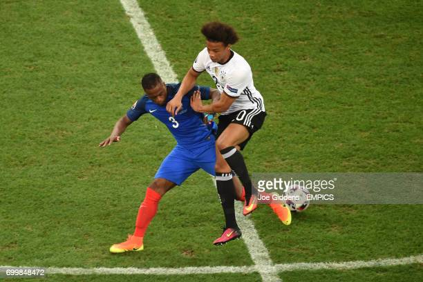 Germany's Leroy Sane and France's Patrice Evra battle for the ball