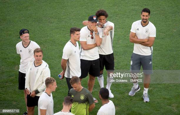 Germany's Leroy Sane and Lukas Podolski share a joke as the team walk the pitch prior to kickoff