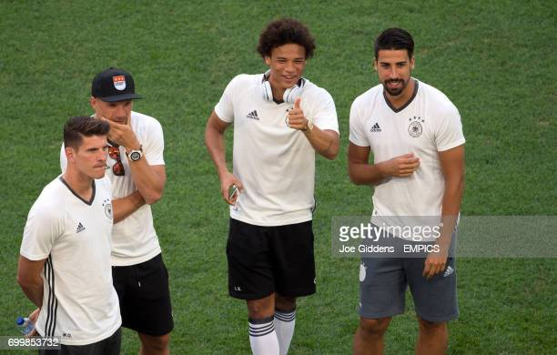 Germany's Leroy Sane gives a thumbs up along side teammate Sami Khedira as the team walk the pitch prior to kickoff