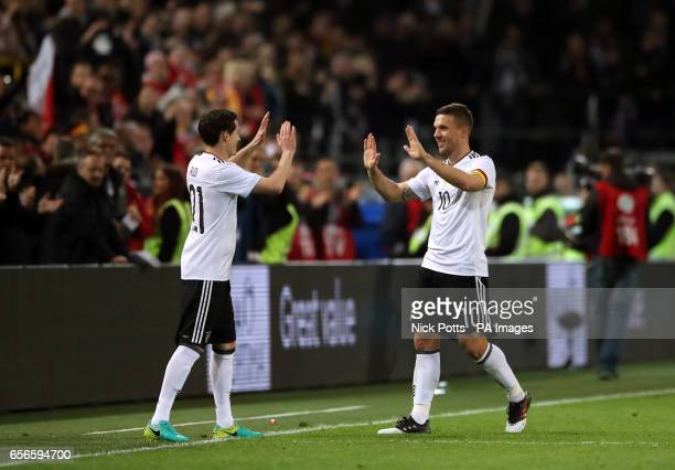 Germany's Lukas Podolski is substituted for Sebastian Rudy in his final game during the International Friendly match at Signal Iduna Park Dortmund