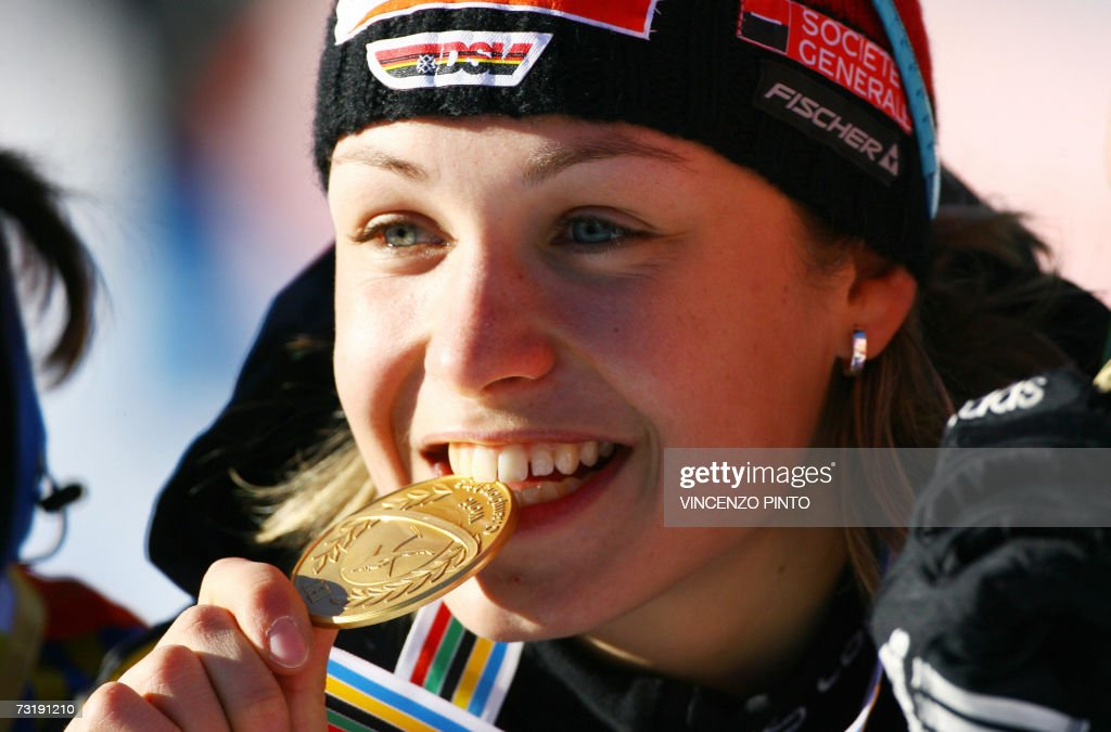 Germany's Magdalena Neuner poses with her gold medal after the Women's 7,5 km sprint race of the Biathlon World Championship in Anterselva 03 February 2007. Neuner won the race and gold medal ahead of Swedish Anna Carin Olofsson and Russian Natalia Guseva.