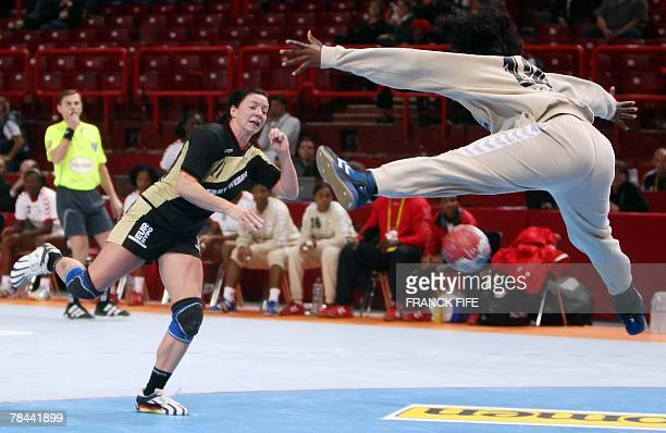 Germany's Mandy Hering tries to score in front of Angola's goalkeeper Maria Pedro during their Women Handball World Championship quarter final match...
