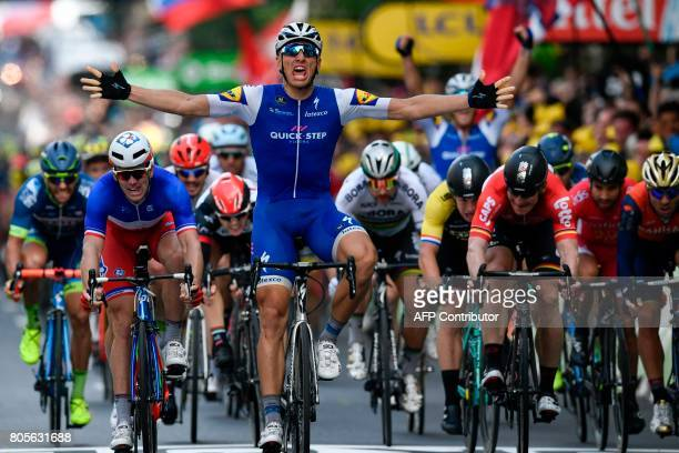 Germany's Marcel Kittel celebrates as he crosses the finish line ahead of France's Arnaud Demare Slovakia's Peter Sagan and Germany's Andre Greipel...