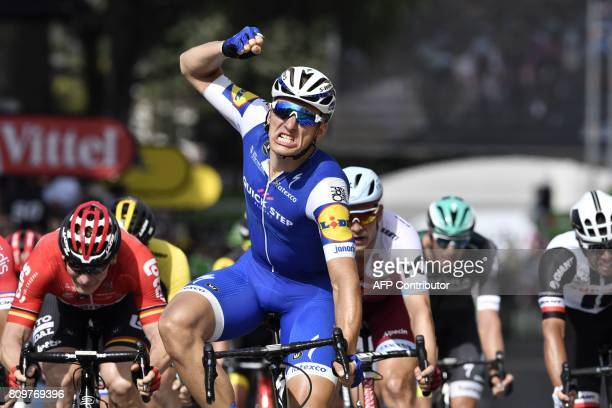 TOPSHOT Germany's Marcel Kittel celebrates as he crosses the finish line ahead of Germany's Andre Greipel during the 216 km sixth stage of the 104th...