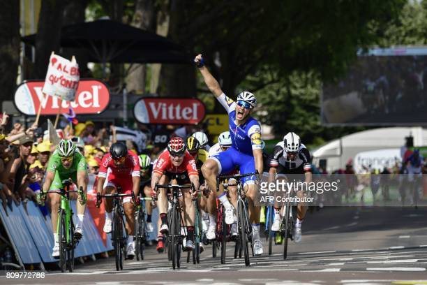 TOPSHOT Germany's Marcel Kittel celebrates as he crosses the finish line ahead of France's Arnaud Demare wearing the best sprinter's green jersey...