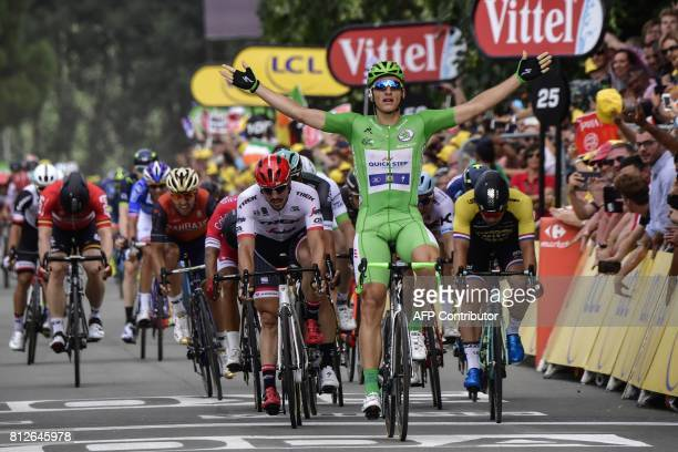 TOPSHOT Germany's Marcel Kittel celebrates as he crosses the finish line ahead of Germany's John Degenkolb at the end of the 178 km tenth stage of...