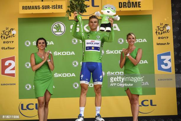 Germany's Marcel Kittel celebrates his green jersey of best sprinter on the podium at the end of the 165 km sixteenth stage of the 104th edition of...