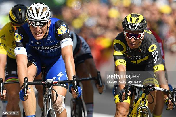 Germany's Marcel Kittel crosses the finish line ahead of France's Bryan Coquard and Slovakia's Peter Sagan wearing the overall leader's yellow jersey...