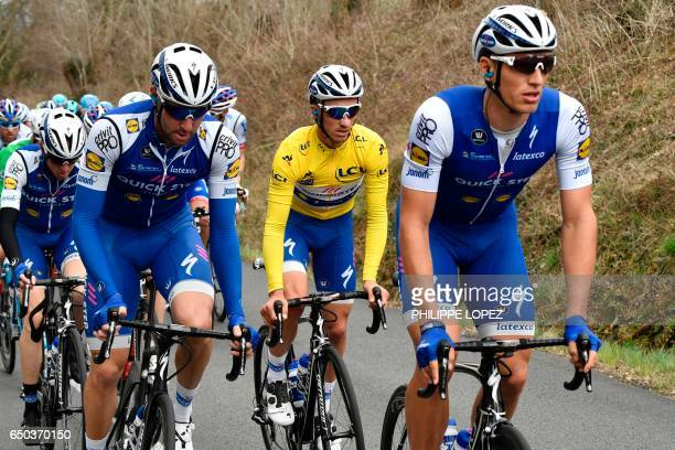 Germany's Marcel Kittel France's Julian Alaphilippe wearing the overall leader's yellow jersey and Italy's Fabio Sabatini ride in the pack during the...