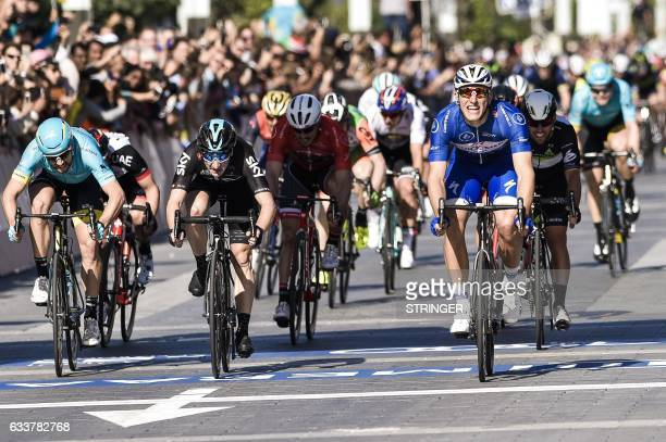 Germany's Marcel Kittel from Belgium's QuickStep Floors Team passes the finish line as he wins the Merass stage 5 during the Dubai Tour 2017 on...