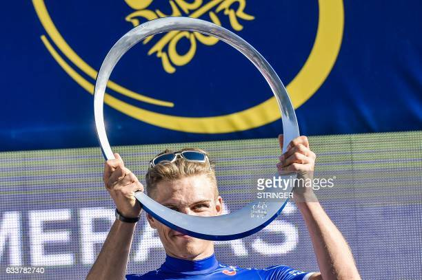 Germany's Marcel Kittel from Belgium's QuickStep Floors Team poses with the trophy on the podium upon winning the Dubai Tour 2017 on February 4 2017...