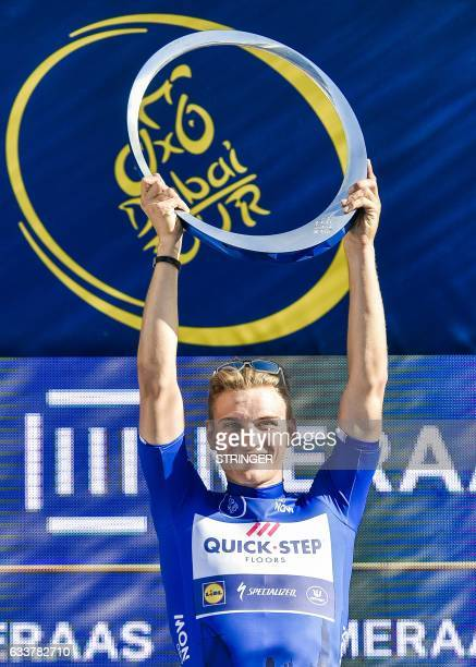 Germany's Marcel Kittel from Belgium's QuickStep Floors Team raises the trophy on the podium upon winning the Dubai Tour 2017 on February 4 2017...