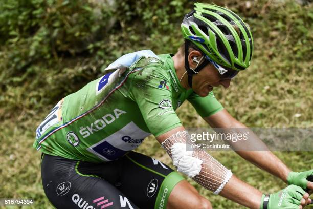 TOPSHOT Germany's Marcel Kittel wearing the best sprinter's green jersey injured after falling rides during the 183 km seventeenth stage of the 104th...