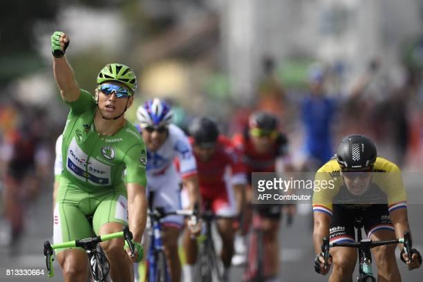 Germany's Marcel Kittel wearing the best sprinter's green jersey celebrates as he crosses the finish line ahead of Netherlands' Dylan Groenewegen at...