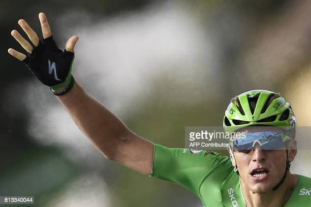 Germany's Marcel Kittel wearing the best sprinter's green jersey makes the sign five for his fifth consecutive victory as he crosses the finish line...
