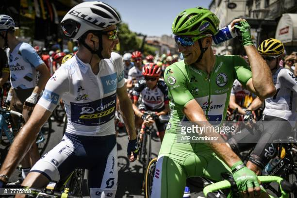 Germany's Marcel Kittel wearing the best sprinter's green jersey speaks with Great Britain's Simon Yates wearing the best young's white jersey prior...