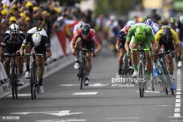 Germany's Marcel Kittel wearing the best sprinter's green jersey sprints to win ahead of Australia's Michael Matthews Norway's Edvald Boasson Hagen...