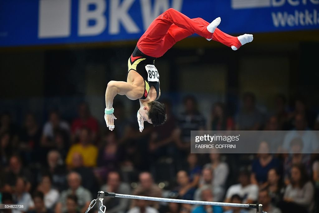 Germanys Marcel Nguyen performs during the Mens Horizontal Bar competition of the European Artistic Gymnastics Championships 2016 in Bern, Switzerland on May 28, 2016. / AFP / FABRICE