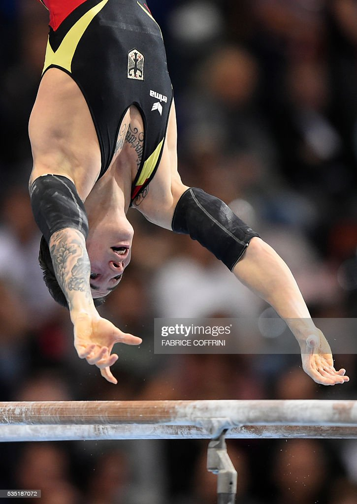 Germanys Marcel Nguyen performs during the Mens Parallel Bars competition of the European Artistic Gymnastics Championships 2016 in Bern, Switzerland on May 29, 2016. / AFP / FABRICE