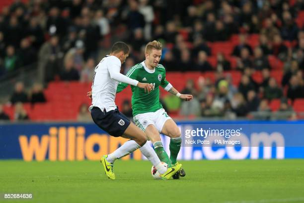 Germany's Marco Reus and England's Chris Smalling battle for the ball