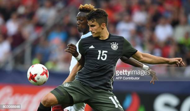 Germany's MarcOliver Kempf and England's forward Tammy Abraham vie for the ball during the additional time during the UEFA U21 European Championship...