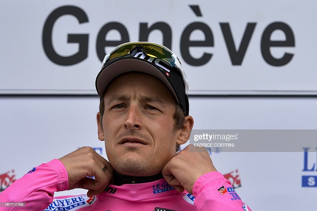 Germany's Marcus Burghardt adjustes his pink jersey for the best mountain climber of the tour de Romandie cycling race during the podium ceremony after the final stage, a 18,7 km time trial, on April 28, 2013 in Geneva.