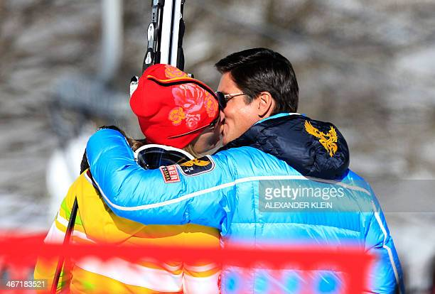 Germany's Maria HoeflRiesch kisses her husband and manager Marcus Hoefl after her Women's Alpine Skiing Downhill training session at the Rosa Khutor...