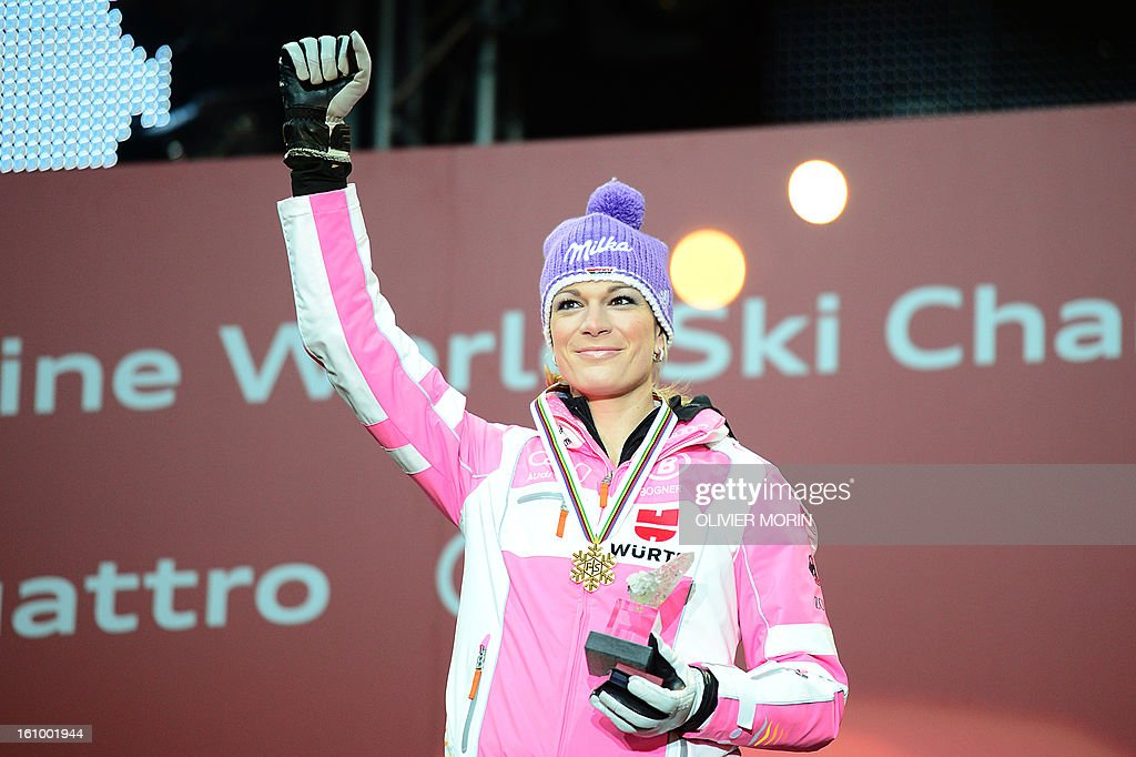 Germany's Maria Hoefl-Riesch raises a fist with her gold medal after winning the women's Super Combined event at the 2013 Ski World Championships in Schladming, Austria on February 8, 2013. Hoefl-Riesch won the event ahead of Slovenia's Tina Maze and Austria's Nicole Hosp. MORIN