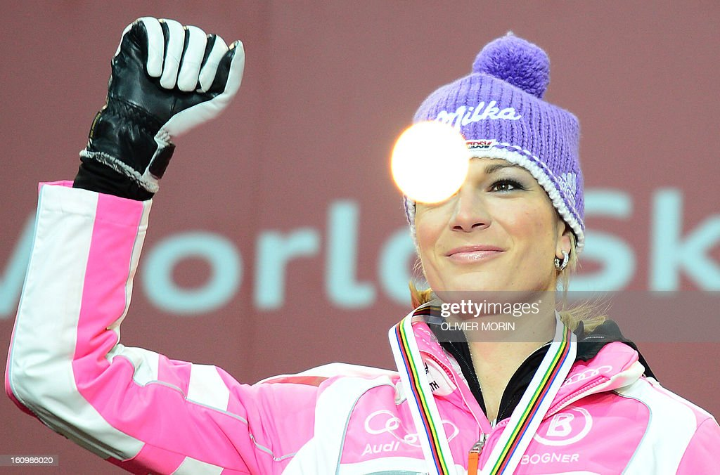 Germany's Maria Hoefl-Riesch raises her fist with her medal after the women's Super Combined event at the 2013 Ski World Championships in Schladming, Austria on February 8, 2013. Hoefl-Riesch won the event ahead of Maze and Hosp. MORIN