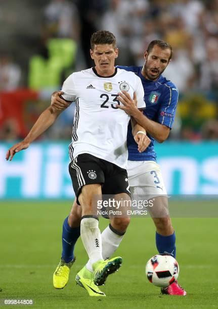 Germany's Mario Gomez and Italy's Giorgio Chiellini battle for the ball
