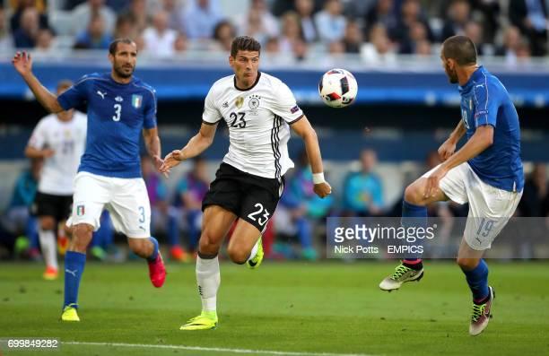 Germany's Mario Gomez in action with Italy's Leonardo Bonucci