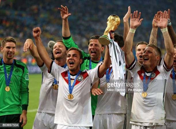 Germany's Mario Gotze and Bastian Schweinsteiger celebrates after Germany won the FIFA World Cup Final at the Estadio do Maracana Rio de Janerio...
