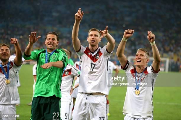 Germany's Mario Gotze goalkeeper Roman Weidenfeller Per Mertesacker and Bastian Schweinsteiger celebrate winning the World Cup Final