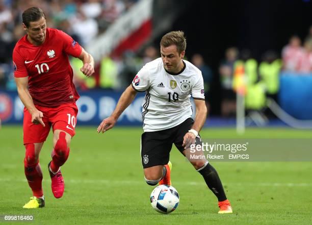 Germany's Mario Gotze takes on Poland's Grzegorz Krychowiak