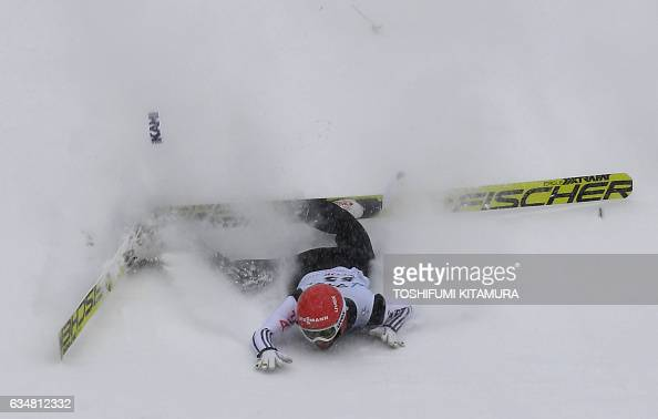 TOPSHOT Germany's Markus Eisenbichler falls right after landing in his second jump during the FIS Ski Jumping World Cup in Sapporo on February 12...