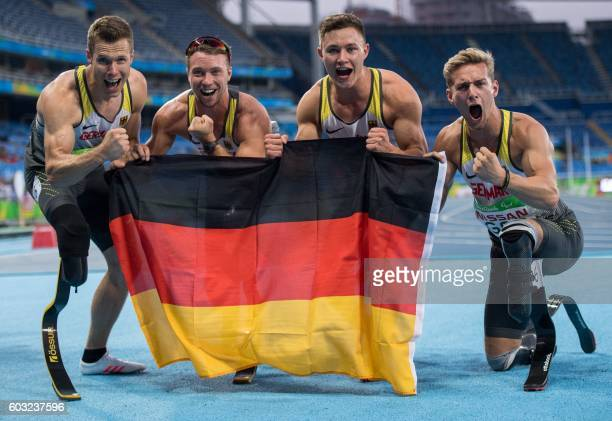 Germany's Markus Rehm David Behre Felix Streng and Johannes Floors pose for a photo after winning the gold medal in the men's 4x100m T4247 final in...